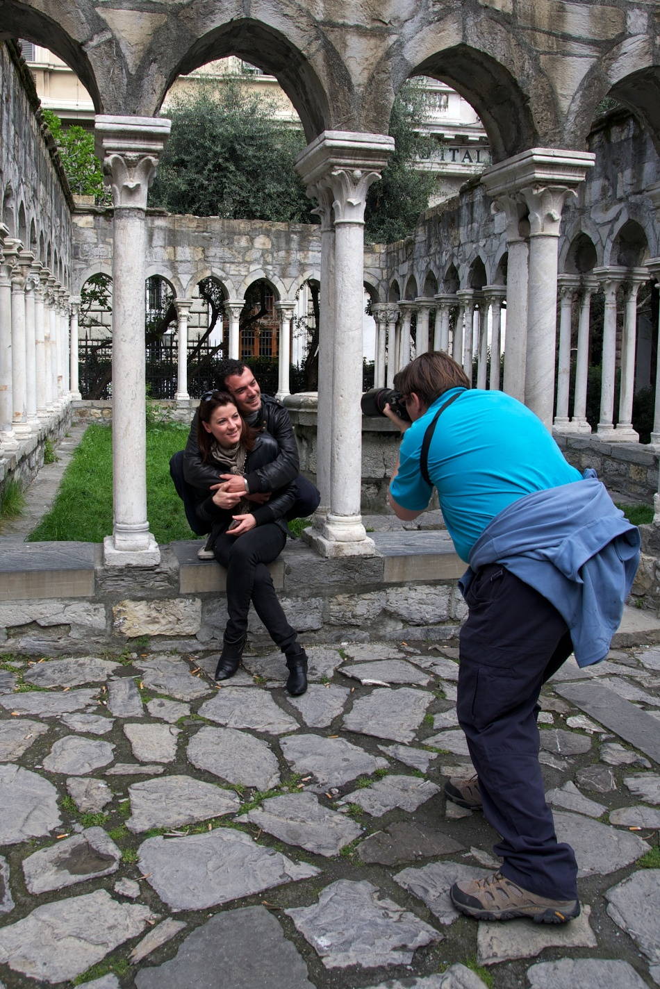 Photographer photographing a young couple in Genoa, Italy
