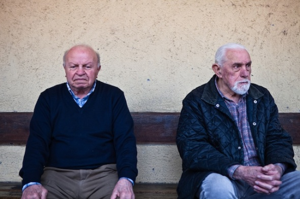 two elderly men on a bench